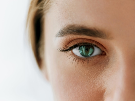 Close up on woman's green eye